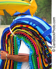 illegal immigrant while sells accessories and towels along...
