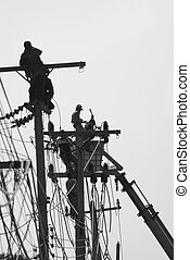 Maintenance work - Silhouette men performing maintenance...