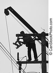 Maintenance work - Silhouette of man performing maintenance...