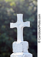 White cross on a cemetery