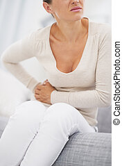 Closeup on young woman having stomach pain - Closeup on...