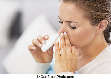 Woman using nasal drops - Closeup on pills pack in hand of...