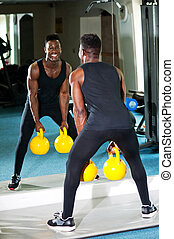 Man working out with kettlebell
