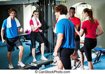 Exercise regularly, stay fit - Young couple working out in...