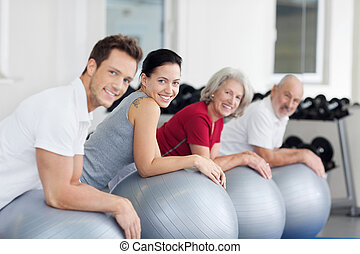 Group exercising in a gym - Group of diverse young and...