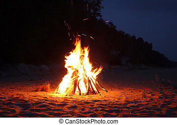 Campfire on the beach - Inviting campfire on the beach in...