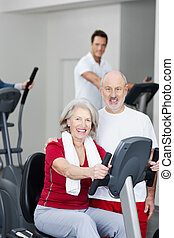 Senior couple training in a gym - Active attractive senior...