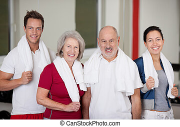 Happy Family Standing In Gym - Portrait of happy family...