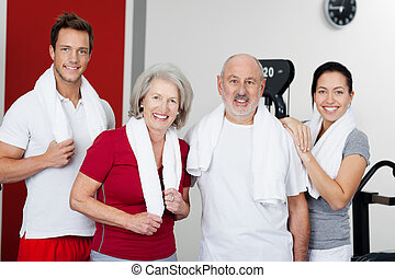 Happy Family Standing Together In Gym - Portrait of happy...