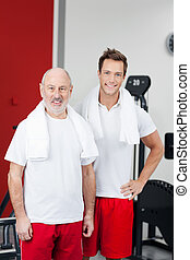 Happy Father And Son Standing At Gym - Portrait of happy...