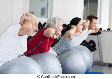 Happy Family Exercising On Swiss Ball - Side view of happy...
