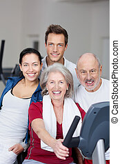 Family Smiling Together In Gym - Portrait of fit family...
