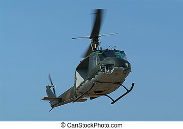Military Helicopter - Military helicopter with camouflage...
