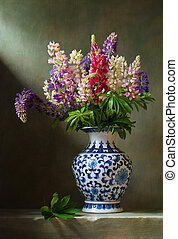 Still life with flowers lupine in a chinese vase