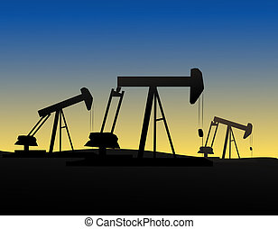 Oil Derricspumpjacks silhouetted against the evening sky