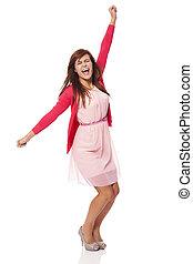Young beautiful woman screaming of joy