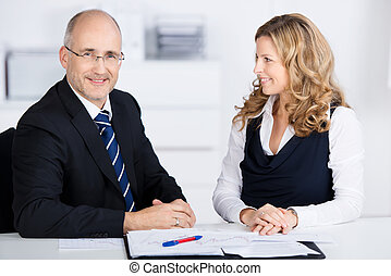 Two coworkers having a meeting - Two coworkers, a...