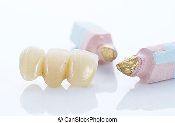 Macro of prosthetic teeth with dental tools