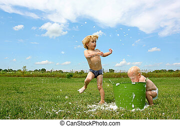 Children Playing in Bubbley Water