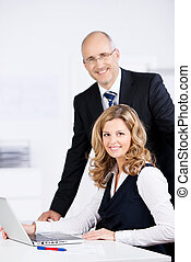 Competent dedicated business team working together in the...