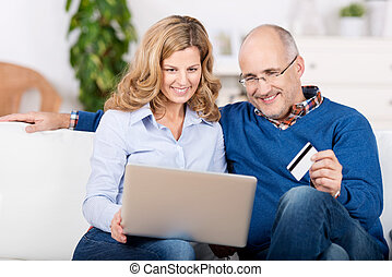 Married couple ordering on the internet - Attractive married...