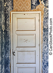 shut door in abandoned house - Shut wooden door peeling wall...