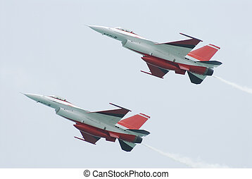F-16 airplanes - Two white and red F-16 fighter airplanes...