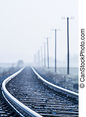 Railway line in morning fog in rural Bavaria, Germany