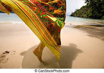 Tropical Holiday - A woman\'s skirt blowing in the wind on a...