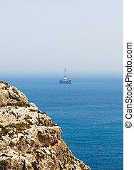 oil derrick and the cliffs, Malta - oil derrick and the...