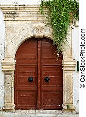 Old door in city of Rethymno, Crete, Greece
