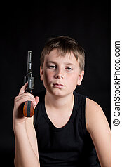 teenager with a gun on a black background