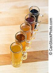 beer flight of five sampling mugs of light and dark craft...