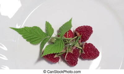 Raspberries on a plate Top view