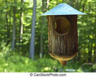 Rustic Birdfeeder - Rustic birdfeeder hanging over a wild...