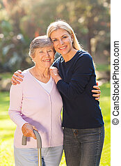 mature woman with her senior mother outdoors - beautiful...