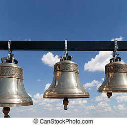 Orthodox bells closeup against the sky with clouds. New...