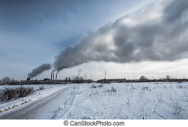 Power plant pollutes the environment, winter shot