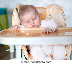 baby fell asleep after eating at the table