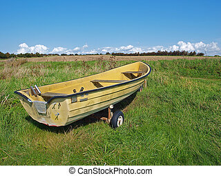 Small Skiff boat on the seashore field - Small fishing Skiff...