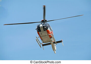 Helicopter landing - Orange and gray coloured helicopter...