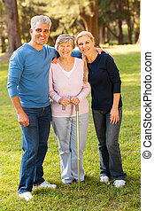 middle aged couple and mother outdoors - portrait of middle...