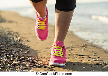 Outdoor runner - Young woman is running in sunny nature...