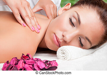 Woman in a Spa - Young woman lying in a spa ready to get a...