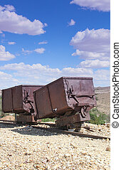 2 vintage gold/silver ore carts - red rusted vintage...
