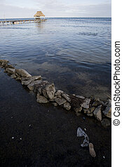 Tidal Rocks and Pier at Sunset - Tidal rocks and calm waters...