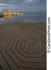 Circular Pier and water - A circular pier, small hut and...