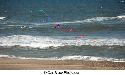 Fast Moving Kites - Kites blowing in the wind at an...