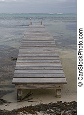 Small Wooden Pier and Gulf waters - A short wooden pier on...