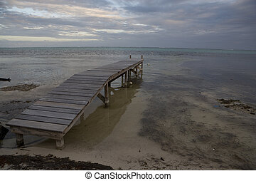 Short Wooden Pier at Sunset - A short wooden pier juts out...